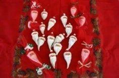 Milkweed pods painted like Santa.