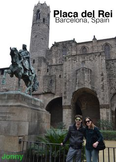 There's a castle and a statue of a guy on a horse at Placa del Rei in Barcelona, Spain
