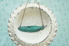 Patina Feather necklace by girlsdayout, $22.00