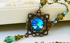 New Vintage Swarovski Rivoli Green Sphinx Crystal Vintaj Filigree Pendant Drop Necklace on Etsy, $32.00