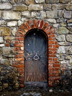 Old locked door. Photo by AlladdinSE.