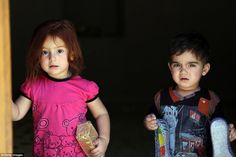Persecuted: Yazidi children (pictured) have taken to sheltering in the holy valley of Lalish, while others trapped in the Sinjar Mountains were flown renewed supplies by the U.S. today. The religious minority is not alone in being threatened by the militants, who also say Christians and Shia Muslims are heretics and should convert.