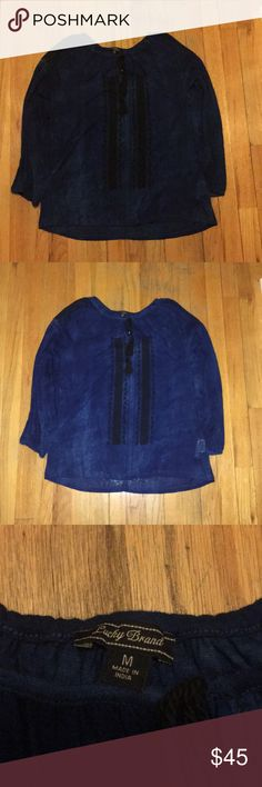 """NWT Lucky Brand dark blue/navy """"boho style"""" shirt Very cute brand new lucky brand long sleeve shirt. This """"boho style"""" shirt has strings in the front of the shirt and cute black embroidered details on the front center and shoulders. The shirt was purchased for $69.50 and I am willing to work out a deal with you! Tops"""