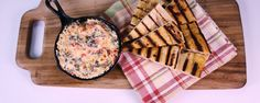 Swiss Chard Ricotta Dip with Grilled Pizza Dippers--Did someone say chips n' dip? Daphne's Italian inspired snack is perfect for your next party!