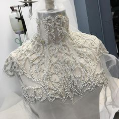 Intricate pearl and crystal beaded collar being worked on in the studio today! New bridal collection is weeks away!