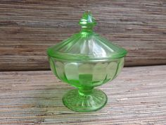 Check out this item in my Etsy shop https://www.etsy.com/listing/479742855/vintage-green-depression-glass-covered