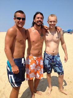Dave Grohl of Foo Fighters (center) with fans at the beach
