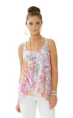 The Sarina silk tank is a racerback top with a high-low hemline. This fun printed tank goes great with white denim or Callahan shorts.