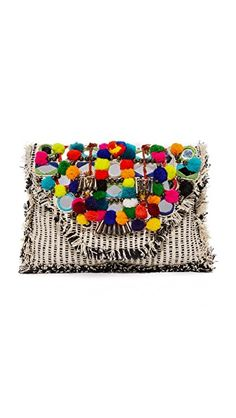 ¡Consigue este tipo de bolso de mano de Antik Batik ahora! Haz clic para ver los detalles. Envíos gratis a toda España. Antik Batik Udipi Clutch: An intricate arrangement of pom-poms and mirrors adds festive detail to the magnetic top flap of this slim Antik Batik clutch. Tufts of fringe trim the edges. Lined, 1-pocket interior. Leather cross-body strap. Fabric: Basket weave. Weight: 12oz / 0.34kg. Imported, India. Measurements Height: 9in / 23cm Length: 13.5in / 34cm Strap drop: 21.25in…