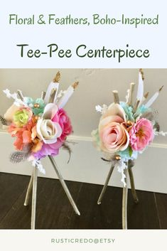 """These handmade floral & feathers, tee-pee style centerpieces are adorable! They would be perfect for a boho or """"wild one"""" birthday party or baby shower, tribal or native american party or baby shower. 