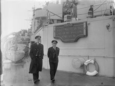 HM King Haakon of Norway walking with Vice Admiral McGrigor on the quarterdeck of HMS NORFOLK during the royal family's return to Oslo at the end of the war. The royal family escaped from Norway after the German invasion.