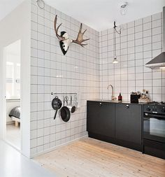 Love the contrast between monochromatic black and white and the ubiquitous antler...now in the kitchen