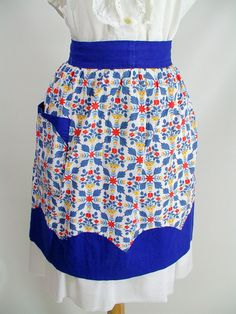 1950s Pennsylvania Dutch vintage half apron with pocket and blue trim and ties. $18.00, via Etsy.