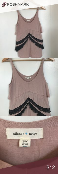 Urban Outfitters Ruffle Lace Tank (XS) Adorable Silence & Noise tank from Urban Outfitters in dusty pink with black lace ruffles to cover up all those midsection flaws! Size XS. Small oil stain on front that is not noticeable when wearing (see 2nd picture) Urban Outfitters Tops Tank Tops