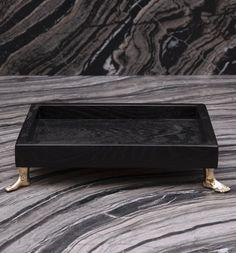 KELLY WEARSTLER | NARCISSUS TRAY. Ebonized wood with brass feet
