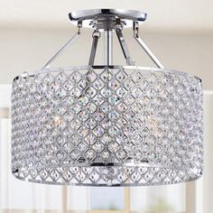@Overstock - Chrome/ Crystal 4-light Round Ceiling Chandelier - Create a focal point for any room with these dramatic crystal chandeliers. Each chandelier is constructed with a wide, chrome-finished cylindrical frame covered in a web of sparkling crystals, creating a stunning, glittering design showpiece.  http://www.overstock.com/Home-Garden/Chrome-Crystal-4-light-Round-Ceiling-Chandelier/4737578/product.html?CID=214117 $157.49