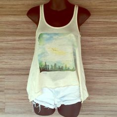 Lilu graphic city tank Sides are longer than the tank. Perfect condition. Light and flowy. 85% polyester 15% linen. Lilu Tops Tank Tops