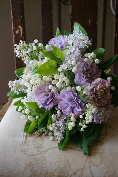 clematis,lilac and lily of the valleyThere are no words to adequately describe how beautiful this is.