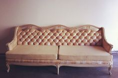 awesome vintage couch available for rent from Bourbon and Bloom