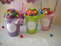 Hmmm. Stuff a cup with supplies or other small gift, cap it, and add candy for a teacher treat?