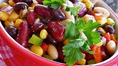 ¡Mexican Bean Salad!  Black beans, kidney beans, and cannellini beans combine with corn, bell pepper, and red onion in this easy and colourful salad. It's tossed with a sensational dressing made with fresh lime juice, cilantro, and cumin.