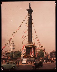 ENGLAND - SEPTEMBER 03: A Dufaycolor colour transparency of Trafalgar Square in London, taken by an unknown photographer in 1945. Nelson's Column is decked with bunting and decorated with the flags of the Allied Powers, part of the celebrations to mark VE (Victory in Europe) Day and the end of World War ll in Europe.
