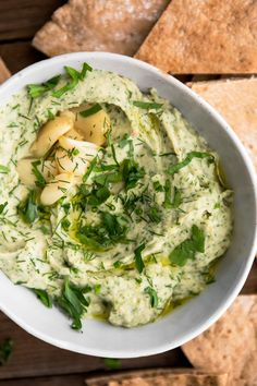 A quick and easy vegan/gluten-free white bean dip that uses roasted garlic and fresh herbs for flavor. Perfect for a picnic or game night!