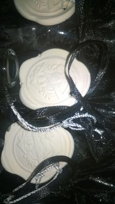 Close up of the hand stamped white clay tags