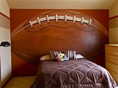 Love the football wall for a boy's room.