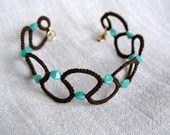 braccialetto chiacchierino marrone con perline turchesi : Braccialetti di ilfilochiaro