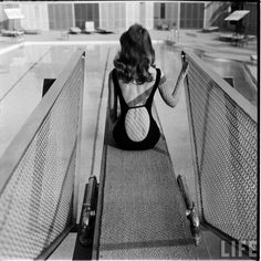 Glamour girl Vikki Dougan poses in a backless bathing suit, photo by Ralph Crane, Beverly Hills