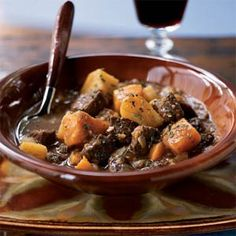 Two-Potato Lamb Stew with Roasted Garlic | MyRecipes.com  Yum Yum and cuddle up after this hearty meal. Add a vegetable rich salad and then just cuddle quietly until the glow wears off from the meal.