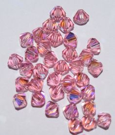 Great beads for your creations. This classic shape works great with any beading project. Beautiful Light Rose AB Swarovski Crystals Size: 4mm #beads #beadsupply #swarovski #swarovskibeads #diy #create #inspiredeye #etsy #makejewelry