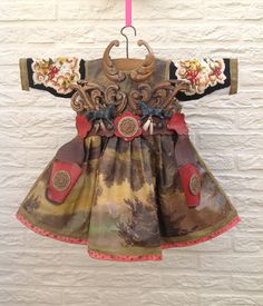 Karin van der Linden ~ Dress *assemblage* made of old paintings - vintage belt - embroidery sleeves. via the artist's board
