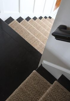 How Our Natural Fiber Stair Runner Has Held Up - Shine Your LightYou can find Stair runners and more on our website.How Our Natural Fiber Stair Runner Has Held . Basement Stairs, House Stairs, Carpet Stairs, Stairs With Carpet Runner, Hallway Carpet, Runners For Stairs, Paint Stairs, Black Painted Stairs, Black Stairs