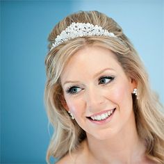 Kathy wore her hair in a half-up half-down style with a beautiful crystal tiara. Click here to read all about Kathy and Mark's real wedding.