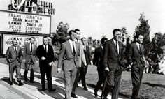 Ocean's Eleven. Frank & Peter Lawford in front, Dean tagging along with Sammy, Joey and the rest. UNDATED.
