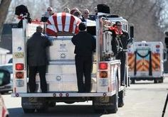 """34 year old Jamison Kampmeyer, laid to rest March 10, 2012. Kampmeyer was fatally injured fighting a fire Sunday March 4, 2012. Kampmeyer, a detective with the county sherrif's department, was a volunteer fireman. Over 1,000 mourners attend his funeral in a small Wisconsin town. Kampmeyer leaves behind a wife, three young children, and an entire community that loved him. A true testement that """"Real Heroes Don't Wear Capes"""" Rest in Peace Hero."""