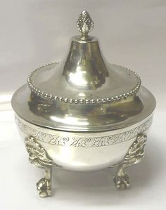 6841. Antique Continental Silver Lemon Box  An excellent quality antique silver box with matching lid. Heavy gauge silver. Attractive pineapple finial and lions mask mounts with ball feet. There is a broad band of hand engraved leaf motifs around the body.