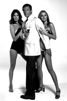 Maud Adams, Roger Moore, and Britt Ekland in a promo still for The Man with the Golden Gun (1974)