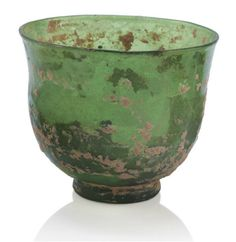 A TRANSPARENT GREEN GLASS CUP TANG-LIAO DYNASTY, 9TH-12TH CENTURY