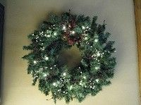 Our Primitive Christmas Wreath - Jingle Bells with Burgundy Pip Berries (Battery Lights) would be a perfect addition to your Christmas decor.  http://www.primitivestarquiltshop.com/Primitive-Christmas-Wreath--Jingle-Bells-with-Burgundy-Pip-Berries-Battery-Lights_p_6393.html