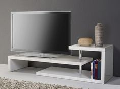 Display your television set in a very stylish way with the Concord TV Stand. Unlike clunky television stands and cabinets, this one takes a fresh approach, allowing you to display your television in a chic, stylish way.