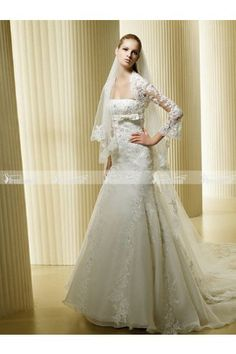 Lace top elegant white wedding dress with a chapel train