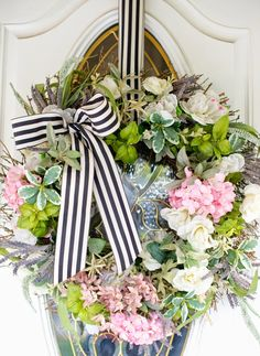 Spring wreath with black and white stripped bow