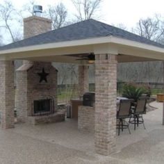 Detached covered patio with custom outdoor fireplace