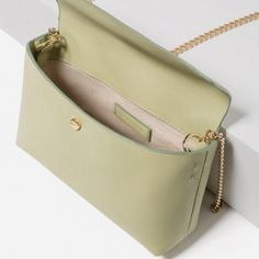 NWT ZARA cross- body bag NWT Zara cross- body bag, faux leather. Light green color. Chain shoulder strap. Golden magnet fastening. Height /width/ depth: 15 cm/ 23 cm/ 7 cm. Zara Bags Crossbody Bags