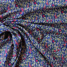 100% viscose. Light weight drapey fabric, 140cm wide. Sold per half metre. To purchase 1 metre, enter 2 in the quantity box at checkout.