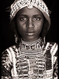 Girl from Africa with beautiful eyes by photographer John Kenny.