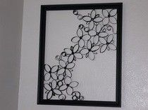 Faux Wrought Iron Wall Art Made out of toliet paper rolls